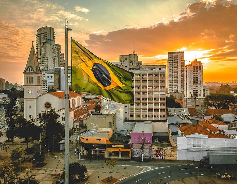 brazilian flag flies over buildings